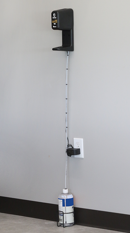 No Stand sanitizer dispenser mounted to the wall