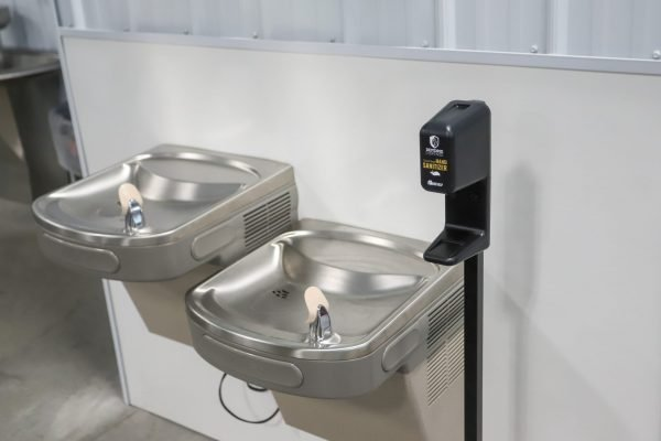 Hand Sanitizer Dispenser by a drinking fountain