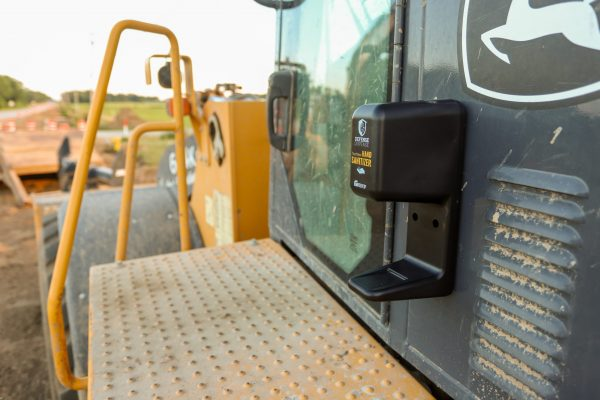 Hand Sanitizer Dispenser on a construction vehicle